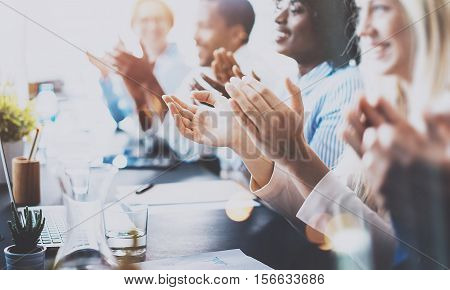 Photo of partners clapping hands after business seminar. Professional education, work meeting, presentation or coaching concept.Horizontal, blurred background