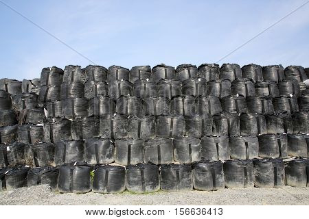 big sandbags for protection against a blue sky