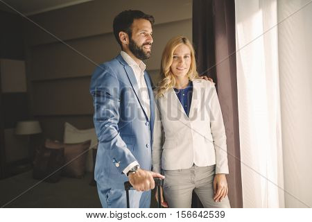 Business young couple traveling to business trip