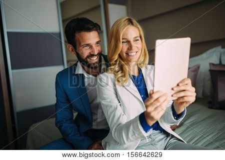 Business colleagues taking selfie on business trip