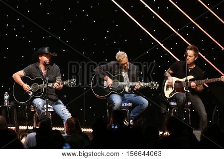 CHICAGO-NOV 9: Jason Aldean (L) performs at CBS Radio's Stars & Stripes event at the Chicago Theatre on November 9, 2016 in Chicago, Illinois.