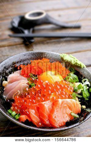 Japanese assorted sashimi rice bowl with scallop, tuna, salmon roe and egg