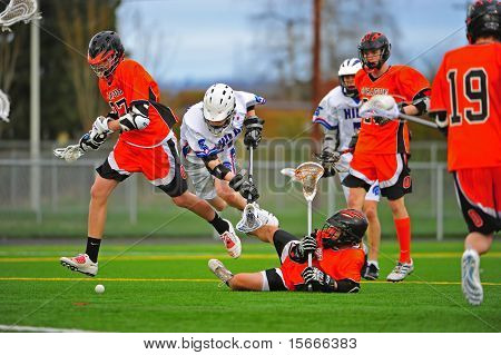 Boys Lacrossecheck Sprague shot on goal