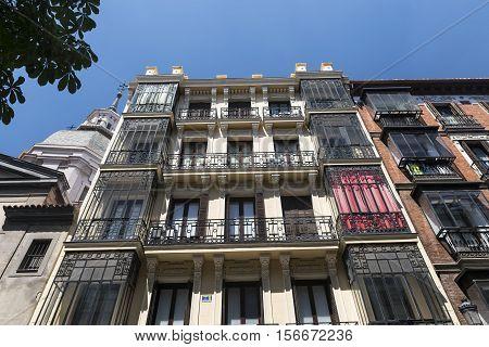 Madrid (Spain): facade of historic palace with balconies and verandas in calle de Atocha