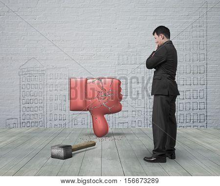 Man Looking At Dislike Thumb Down With Cracks And Hammer