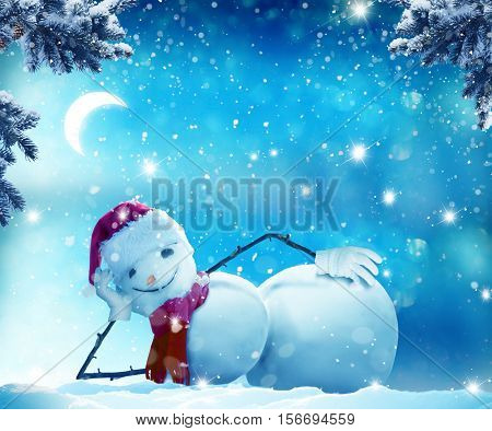 Merry Christmas and happy New Year greeting card with copy-space. Funny snowman   lying in the snow.Winter Christmas landscape.Snow background