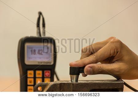 Inspection thickness cast iron by ultrasonic thickness test for found internal defect. UTM