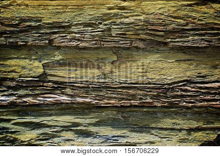 Background of Grey and Green Textured Shale Stone with Weathered Open-pit closeup Outdoors