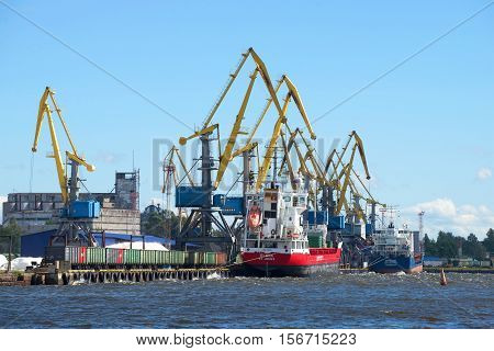 VYBORG, RUSSIA - AUGUST 08, 2016: Two ships on loading in cargo port of the city of Vyborg. Russia. The tourist landmark