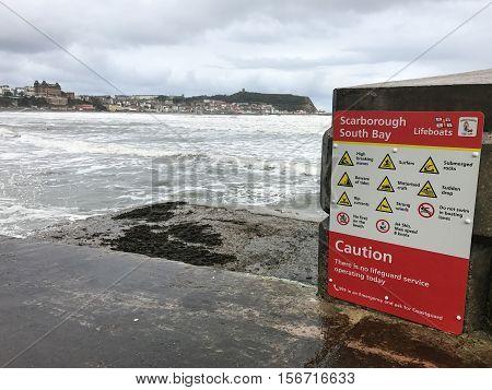 SCARBOROUGH ENGLAND - NOVEMBER 6: Sign warning 'no lifeguard' at Scarborough South Bay. In Scarborough England. On 6th November 2016.