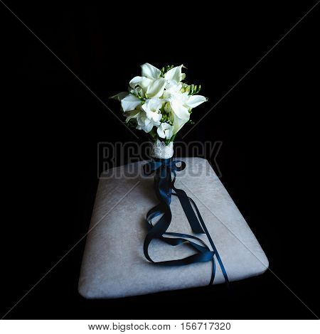Bride's Bouquet Staying On The Gray Pillow