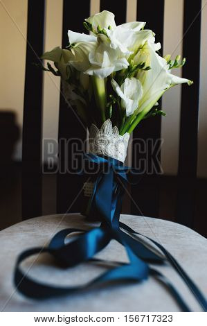 Lily bouquet on the gray pillow in the room
