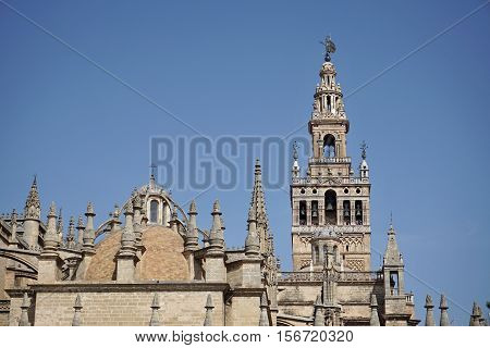 Giralda, famous bell tower of the Seville Cathedral in Spanish city of Sevilla, built as a minaret and rebuilt as a tower of famous church as a symbol of Arab and Moorish architectural period in Spain