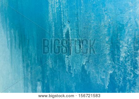 Turquoise Frost Background, Beautiful Closeup Frozen Winter Window Pane Coated Shiny Icy Frost Patterns, Low Temperature, Natural Ice Pattern on a Frosty Glass
