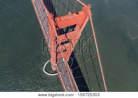 Aerial down view of Golden Gate Bridge tower and San Francisco Bay.