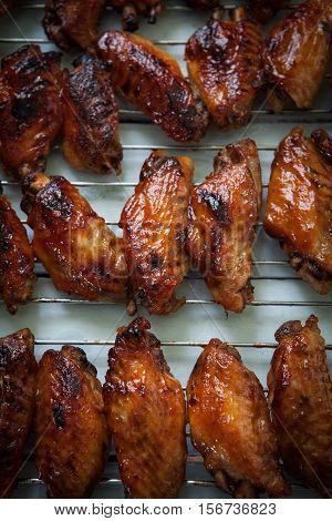 Hot bbq chicken wings on oven tray
