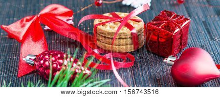 Christmas holiday banner background with cookies and red decorations