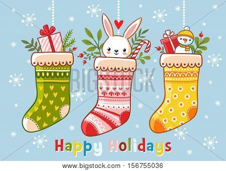 Christmas illustration with christmas socks and gifts in them. Inscription happy holidays on a blue background. Vector illustration. Cute illustration in a children s style.