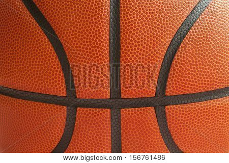 Close up shot of a basketball showing the black seams