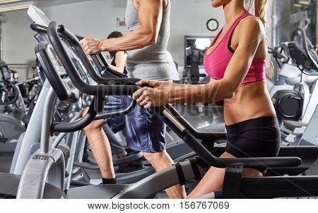 people on elliptical trainer