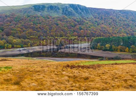 The Penygarreg Reservoir part of Elan Valley Reservoirs showing low water levels in autumn fall. Powys Wales United Kingdom.