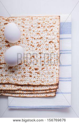 Matza and eggs for Jewish celebration passover.