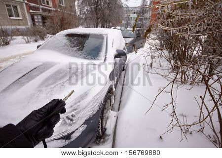 Car is covered icicles, snow and ice after freezing rain and snowfall.