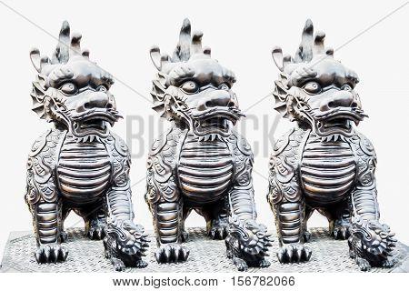 Three sculpture of Dragon-headed unicorn in Thailand.