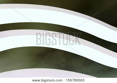Three curved white architectural lines on dark grey cloudy sky. Horizontal 3:2 format.