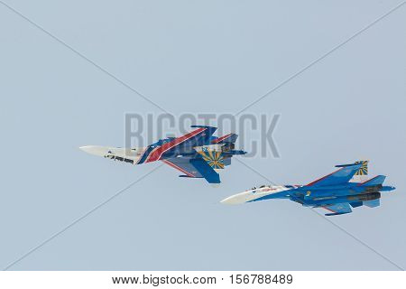 Omsk, Russia - March 19, 2016: Fighter Sukhoi Su-27 show aerobatics at an airshow Russian Knights.