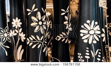 Many engraving flowers on the black wood.