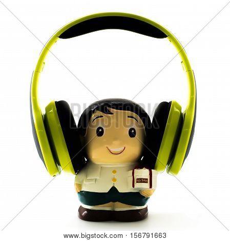A boy doll is listening to music happy birthday.