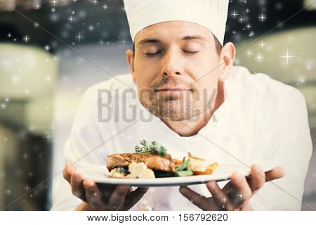 Snow against closeup of a chef with eyes closed smelling food