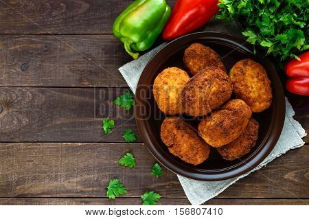Meat mini-rolls (cutlet) with boiled egg. The top view
