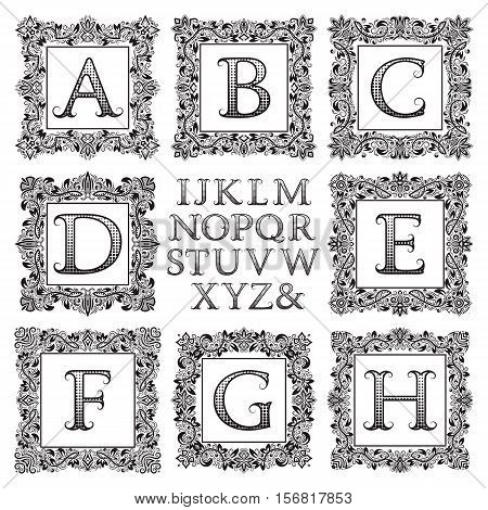 Vintage monogram kit. Black patterned letters and floral square frames for creating initial logo in victorian style.