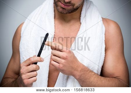 Man using a nail file
