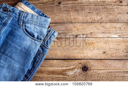 Jeans On A Wooden Background. The Upper Part. Clothing, Fashion, Style, Lifestyle