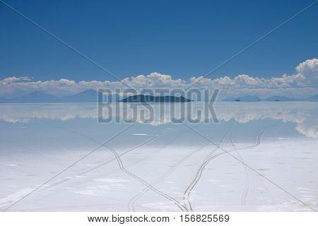 View of the salt lake of salar de uyuni in Bolivia showing tire tracks
