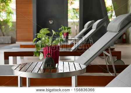 Suntan Chair, Small Table, Decoration Near Swimming Pool