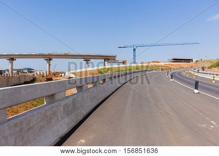 New highway roads junction construction building of ramps exits entry for traffic vehicle flow.