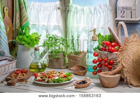 Spring Salad In Country House On Old Wooden Table