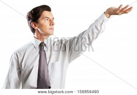 man holding his hand up with palms up like holding an invisible object up high
