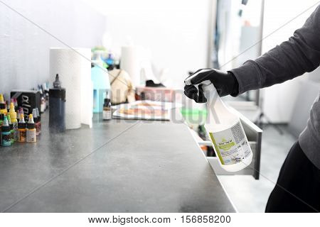 Hygiene and prevention tattoo parlor. Disinfection workplace in the tattoo parlor