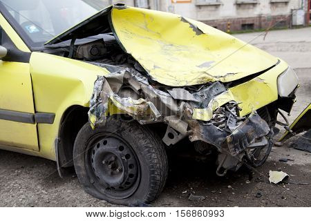 Traffic accident. Yellow crashed car on the strret