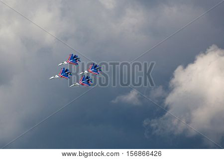 Aerobatic Team Russian Knights At Air Show. Blue Sky In The Background