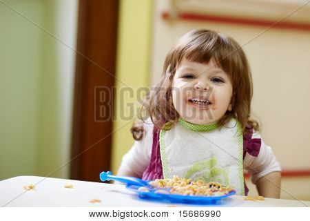 Little Girl Having Lunch At Kindergarten