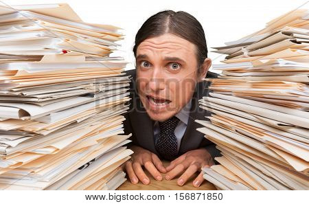 Portrait of a Desperate Employee with Stack of Folders