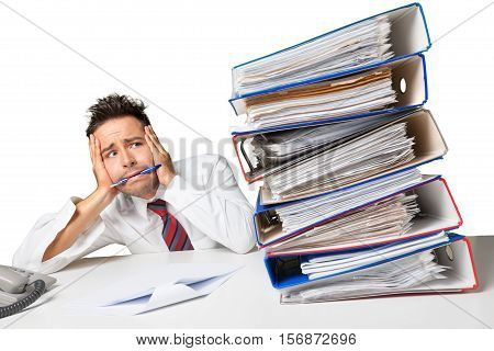 Closeup of a Desperate Businessman Looking at Stack of Folders