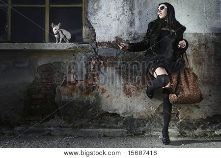 modern punk fashion, portrait of a beautiful model posing dressed In vintage clothes