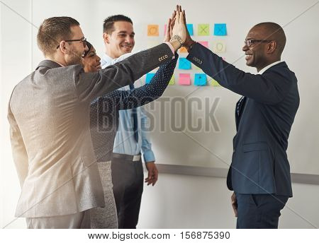 Group Of Business Executives Congratulating